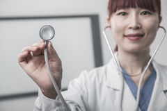 Portrait of female doctor holding a stethoscope Stock Photos