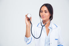 Portrait of a female doctor holding stethoscope Royalty Free Stock Photography