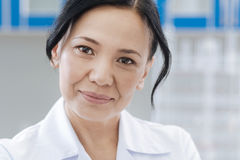 Portrait of female doctor looking at you stock photography