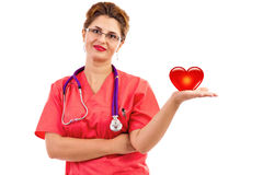 Portrait of a female doctor or nurse with stethoscope holding he Royalty Free Stock Photo