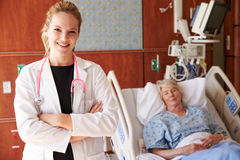 Portrait Of Female Doctor With Patient In Background royalty free stock photo