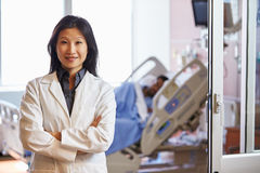 Portrait Of Female Doctor With Patient In Background Royalty Free Stock Images