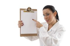 Portrait of female doctor pointing writing pad Stock Photo