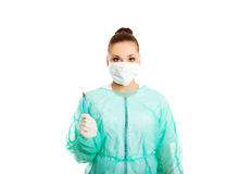 Portrait of female doctor with a scalpel Royalty Free Stock Images