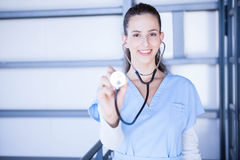 Portrait of female doctor showing stethoscope Royalty Free Stock Photo