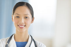 Portrait Of Female Doctor Smiling In Clinic Royalty Free Stock Photography