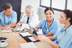 Portrait of female doctor smiling in conference room Stock Photography