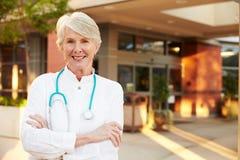 Portrait Of Female Doctor Standing Outside Hospital stock image
