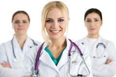 Portrait of female doctor surrounded by medical team Royalty Free Stock Images