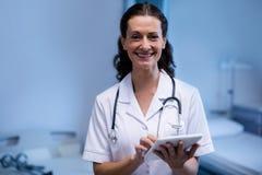 Portrait of female doctor using digital tablet in ward Stock Image