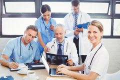 Portrait of female doctor using laptop in conference room Stock Image