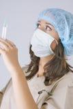 Portrait of female doctor using syringe Stock Photos