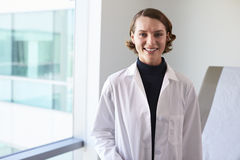 Portrait Of Female Doctor Wearing White Coat In Exam Room Stock Images