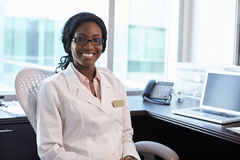 Portrait Of Female Doctor Wearing White Coat In Office Stock Photo
