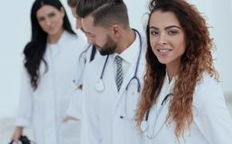 Portrait of female doctors with colleagues. Closeup.portrait of female doctors with colleagues stock image
