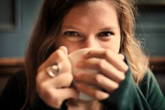 Portrait of Female Drinking from Cup Stock Image