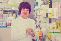 Portrait of  female druggist working in pharmacy Stock Photos