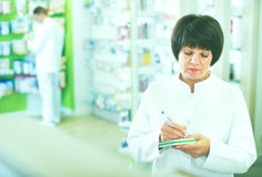 Portrait of  female druggist working in pharmacy Royalty Free Stock Image