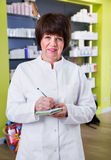 Portrait of  female druggist working in pharmacy Royalty Free Stock Photography