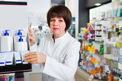 Portrait of  female druggist working in pharmacy Royalty Free Stock Photo