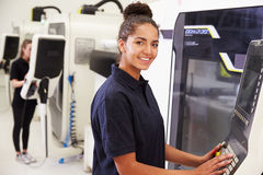 Portrait Of Female Engineer Operating CNC Machinery Royalty Free Stock Photo