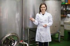 Portrait of female engineer rotating valve Stock Photo