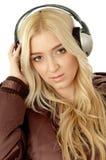 Portrait of female enjoying music. On an isolated background Stock Photography