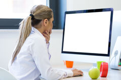 Portrait of female entrepreneur sitting in the office while doin Stock Photo
