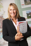 Portrait Of Female Estate Agent In Office royalty free stock photos
