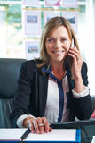 Portrait Of Female Estate Agent On Phone In Office Royalty Free Stock Photography