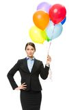 Portrait of female executive keeping colorful balloons Royalty Free Stock Photos