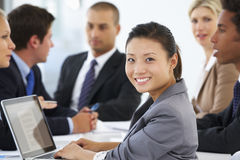 Portrait Of Female Executive With Office Meeting In Background Royalty Free Stock Photography