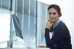Female executive working on computer in office. Portrait of female executive working on computer in office Royalty Free Stock Photos