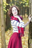 Portrait of Female Fashion Model Posing in Autumn Forest Outdoor Royalty Free Stock Photography