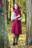 Portrait of Female Fashion Model Posing in Autumn Forest Outdoor Stock Image