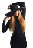 Portrait of female fashion model posing in black hat Royalty Free Stock Image