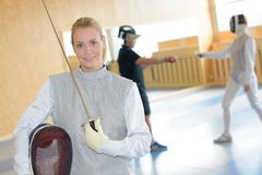 Portrait of female fencer. Female royalty free stock image