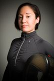 Portrait of a female fencer wearing fencing uniform and holding Royalty Free Stock Photos