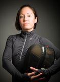 Portrait of a female fencer wearing fencing uniform and holding Royalty Free Stock Images