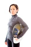 Portrait of a female fencer wearing fencing uniform and holding Stock Images