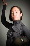 Portrait of a female fencer wearing fencing uniform and holding Royalty Free Stock Photo