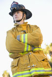 Portrait of a female firefighter. Looking away from camera royalty free stock photos