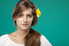 Portrait of female with flower over the ear Royalty Free Stock Photo