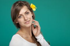 Portrait of female with flower over the ear Royalty Free Stock Image
