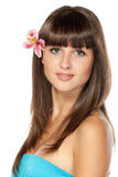 Portrait of female with flower over her ear Royalty Free Stock Photos