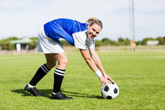 Portrait of female football player keeping a ball stock photo