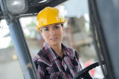 Portrait female fork lift truck driver in factory Stock Photos