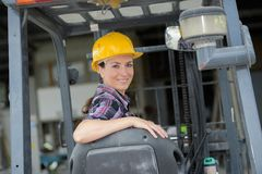 Portrait female fork lift truck driver in factory Stock Photography