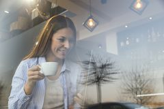 Female freelancer working in a cafe stock image