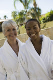 Portrait Of Female Friends In Bathrobe Stock Photography